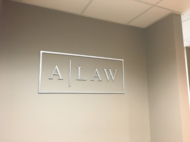 A Law Flat Cut Metal Interior Sign