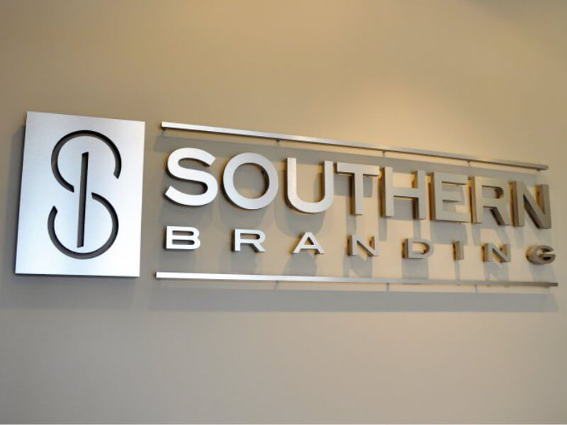 Branding Company Shows Off Logo Wall Sign in Little Rock